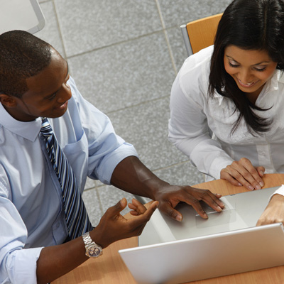 Man and Woman business meeting with laptop