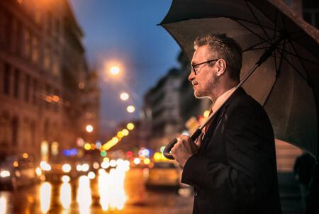 Man with umbrella weather rain